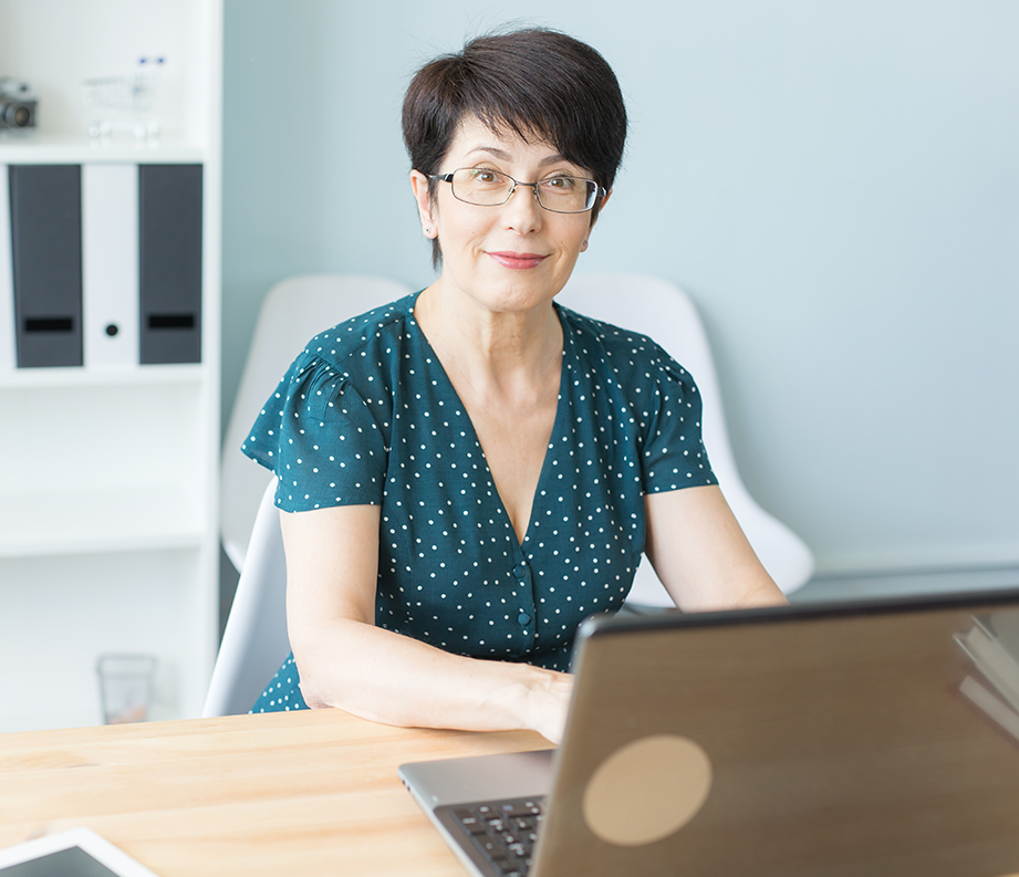 middle aged woman at laptop seeking change and ready to leap!